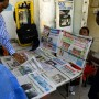 Customers view newspapers at a news stand in Dar es Salam, Tanzania. Mark Henley - Panos Pictures
